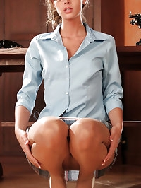 Office secretary in pantyhose and sexy miniskirt