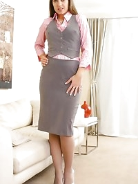 Michaela in cute pink and grey work outfit.