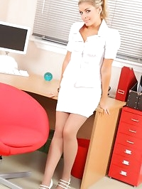 Naughty blonde secretary teases her colleagues as she..