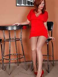 Beauty charms in lusty red high heels