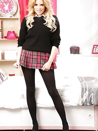 Very short tartan skirt and black opaque pantyhose - a..