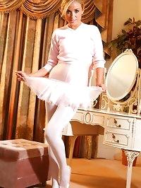 Cute blonde ballerina in a pink leotard and tutu.
