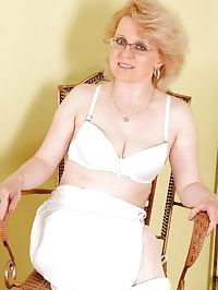 43 year old MILF Margeaux in white lace plays with her..