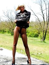 Charming leggy MILF in black pantyhose and stilettos