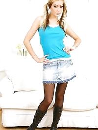 Natasha in denim miniskirt and hides her legs under black..