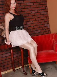 Beauty in pink dress is feeling lusty