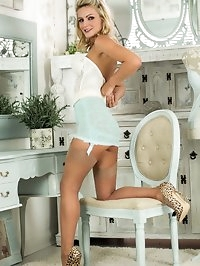 Vanessa strips off her full skirted dress to pose..