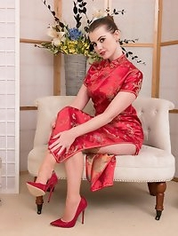 Looking glamorous in satin oriental dress Brook is..