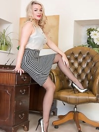 Visit Penny for some expert handjob help. In skimpy blouse..