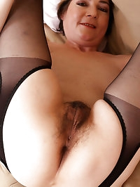 42 year old Eszti in stockings spreading her hairy pussy..