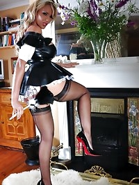 Hot housewife dressed up as latex maid has fun with her..