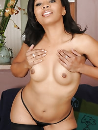 Exotic 33 year old Anita Peida slides out of her sexy..
