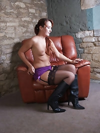 Sammy is wearing purple lingerie and horny leather boots