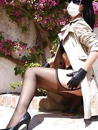 Masked and gloved Femme Fatale
