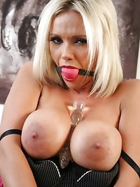 This blonde slut gags her own mouth and then fucks her..
