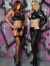 Rebecca poses with guest Carly in their rubber and leather..