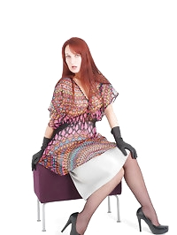 Hot redhead showing off those gorgeous leather gloves of..
