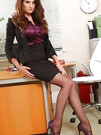 Saucy secretary in a tight black mini skirt suit and..