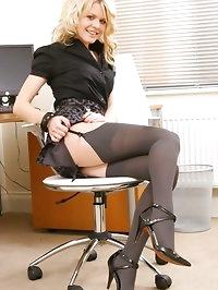 Theo looks amazing dressed as a naughty secretary posing..