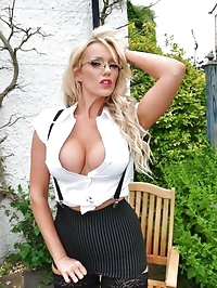 Busty blonde Lucy Zara is out in the garden wearing some..