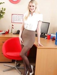 Busty Brooke in the office in black suspenders
