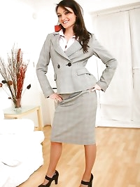 Naughty secretary Laura B slips out of her grey skirt suit..
