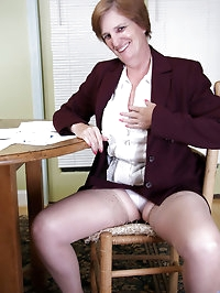Naughty executive granny takes a quick break to strip off..