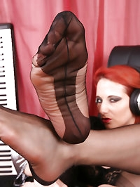 DJ Bitch in fully fashioned black Nylons