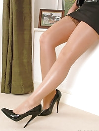 Stunning blonde Kathryn looks elegant in her short skirt..