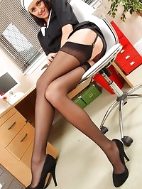 Frisky french maid takes a break from cleaning the office..