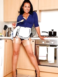 Danica Collins cooking in stockings and suspenders