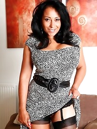 Stunning MILF Danica Collins in stockings and suspenders